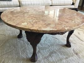 Marble coffee table with carved legs $400