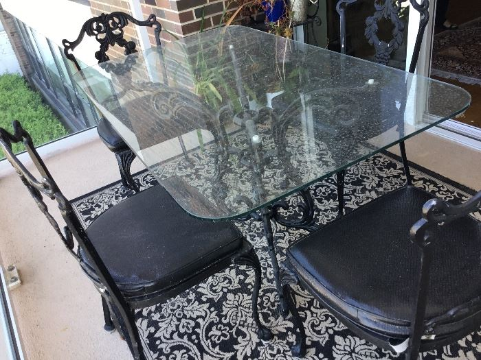 Vintage wrought iron glass table set with 4 matching chairs $485
