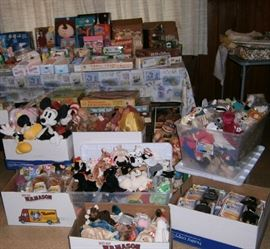 Lots of toys, vintage and newer, Barbies, board games and more.