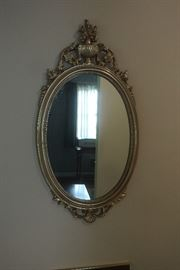 Hall mirror.  Hand carved wood frame.  Gilded.