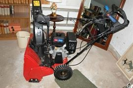 Toro gas powered 4 cycle snow blower.  Very little use.