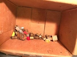 Box of copper and brass plumbing parts
