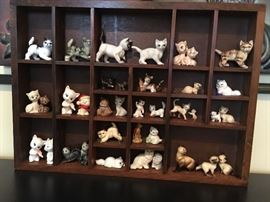 Ceramic, porcelain and china dainty cats with the Enesco display