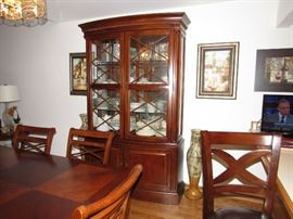 Matching China Cabinet included in price. Gorgeous in cherry wood with 3 glass shelves for displaying your china. The bottom has storage for platters and serving dishes (pictures following) and there is 2 drawers for silver or flat ware.