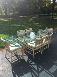 John McGuire Glass Bamboo Table and Six Chairs. Beveled Glass 3/4 thickness height 29 Width 42 length 96  (Glass Table can be sold separately from chairs)