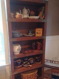 Many bookshelves, Purinton pottery, Hull, vintage picnic basket