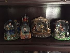 The Snow White and mickey snow globe to the left have both sold