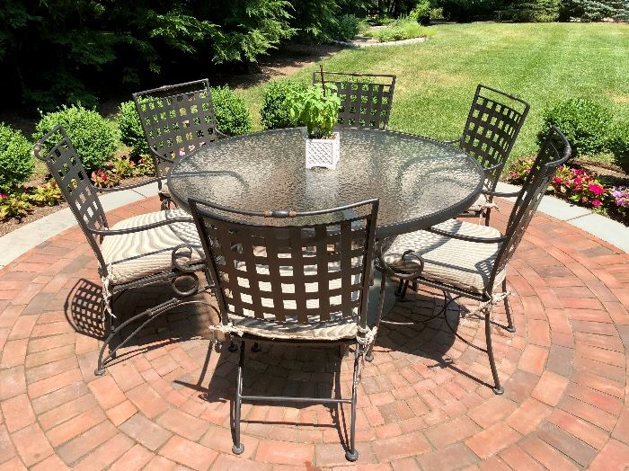 Woodard Sheffield: Squared lattice backs and curled wrought iron arms. Custom Cushions. Woodard Table with obscure glass.