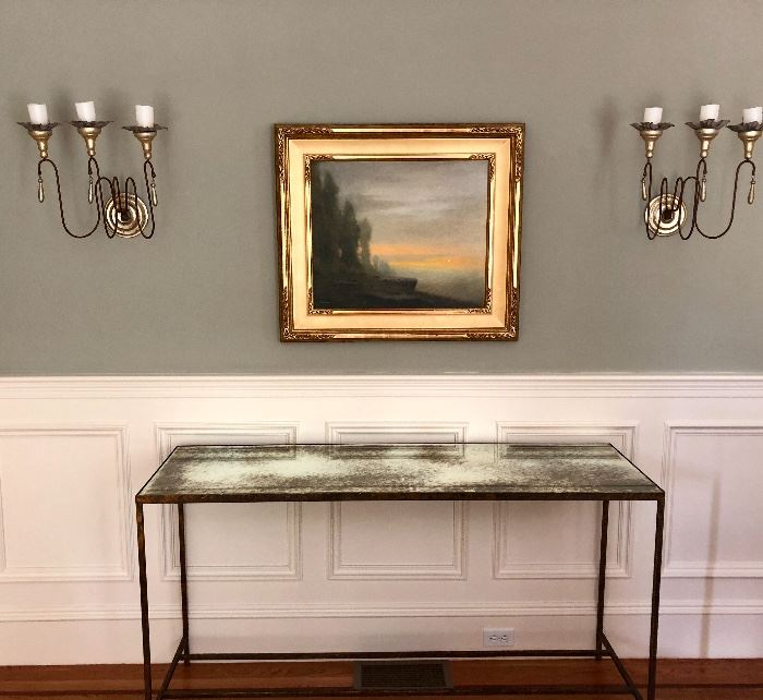 Antique mirror-top console table, heavy metal base. Great wall sconces - Painting not for sale.