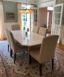 Marble top contemporary dining table and 6 upholstered parsons dining chairs
