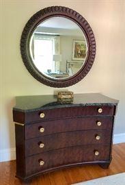 Henredon marble top 4-drawer dresser. Round mirror above.
