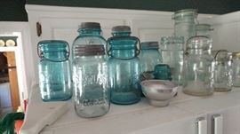 A  variety of older jars.  Some have metal lids.