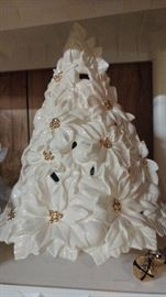 White and gold ceramic Christmas.  Unlike any of the ceramic Christmas trees that I have ever seen.  Taller than average.