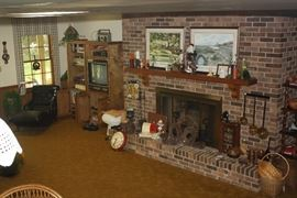 Another panorama of the downstairs area. Don't miss the black lounge chair on the left.