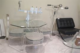 glass table, lucite base, with 4 lucite Regency style chairs, gray seats