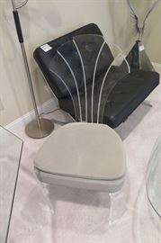 one of the lucite chairs, quite heavy