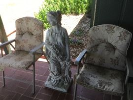 Folding patio chairs, yard art statue