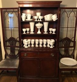 Antique mahogany breakfront cabinet.  Large collection of milk glass.