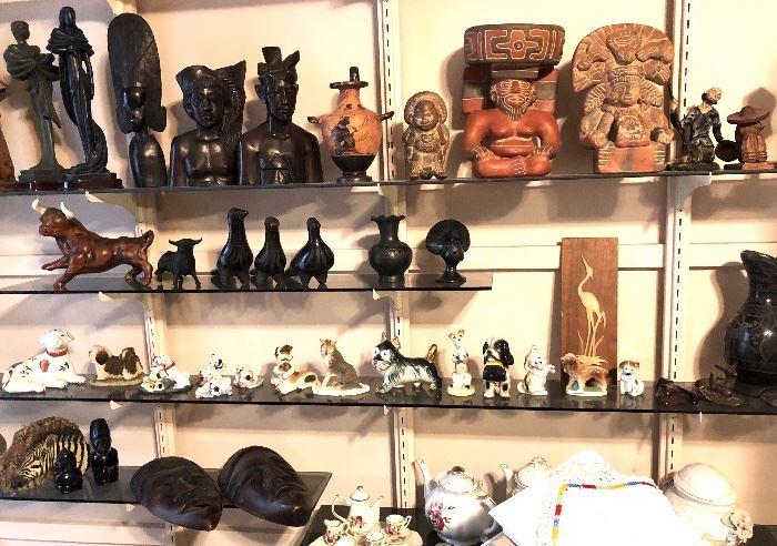Carved wood figures, Greek amphora, Black pottery, porcelain dogs.