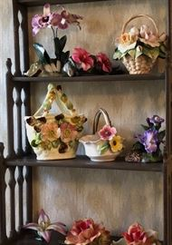 Majolica and capodimonte style flowers.  Wall shelf.