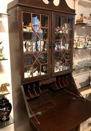 Secretary desk glass front cabinet.