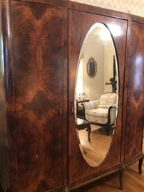 Double armoire, burled wood, oval mirror.  Great for your dressing room or walk in closet.