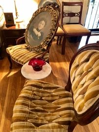 Pair of carved rose chairs with tufted velvet upholstery.