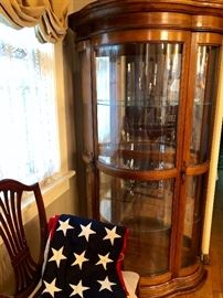 American flag with 48 stars.  Large bow front china display cabinet.