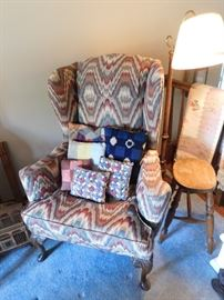 Modern wing chair with pillows made from vintage quilts