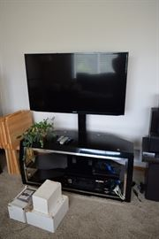 Flat Screen TV, stand, and electronics
