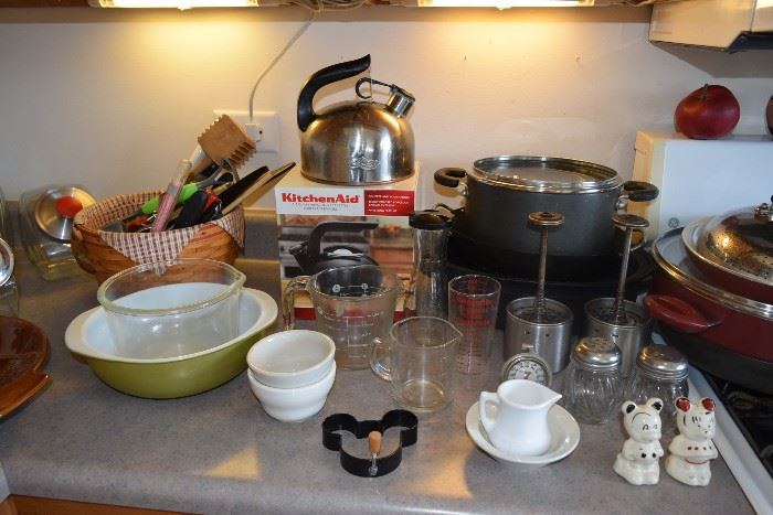 Pots and pans, measuring cups, tea pot, utensils