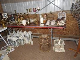 Lanterns, bird cages, brass candle sticks, vintage dress form