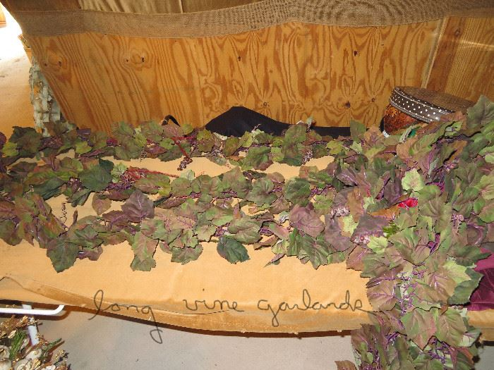 "lots of 5'6"" vine garlands (great for running down center of tables or hanging)"