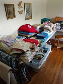 Room full of linens new and vintage