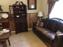 Large leather couch, drop-front china display