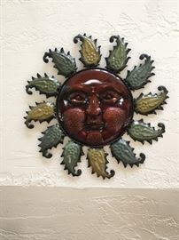 Sun face plaques