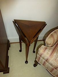 Mahogany table triangular/round table. I believe it to be made at Craftique.