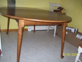 "48"" Round Dining Table with 2 - 12"" Leaves"