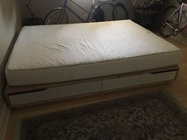 Solid wood platform bed frame with 4 large drawers to allow for storage space. Mattress is included. Bed frame is in excellent condition; Mattress Size: Queen