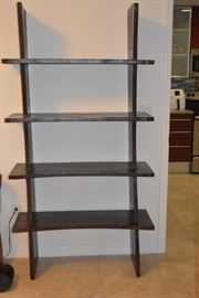 "Real Wood bookcase that is sure to show off your treasures and be a talking piece itself at parties. Two are available Details: Dark Brown in Color; Condition: Excellent; Size: 39 1/4"" x 15.5"" x 74.5"""