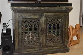 "This real wood cabinet is a versatile piece that will last a lifetime! Use as an entertainment center, cabinet for kitchen, or storage for clothes or any storage you'd like. Details: Distressed Green Wood in Color; Condition: Excellent; Size: 36"" x 20"""