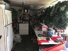 Back porch area - shows refrigerator,  dryer, and lots of Christmas decorations