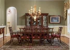 Side view of this glorious Thomasville Dining Room Table with 8 chairs includes two host chairs. and two inserts. Matching Thomasville Hutch includes 3 glass slotted shelves and one flat wood shelf, 5 drawers and two cabinets denotes style and elegance.  Very good buy on these incredible pieces. A must see!