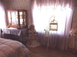 Porcelain doll and double bird cage