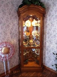 Oak corner lighted curio cabinet