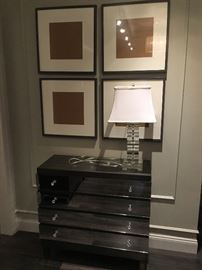 Glass cube lamp, set of four frames, mirrored chest of drawers