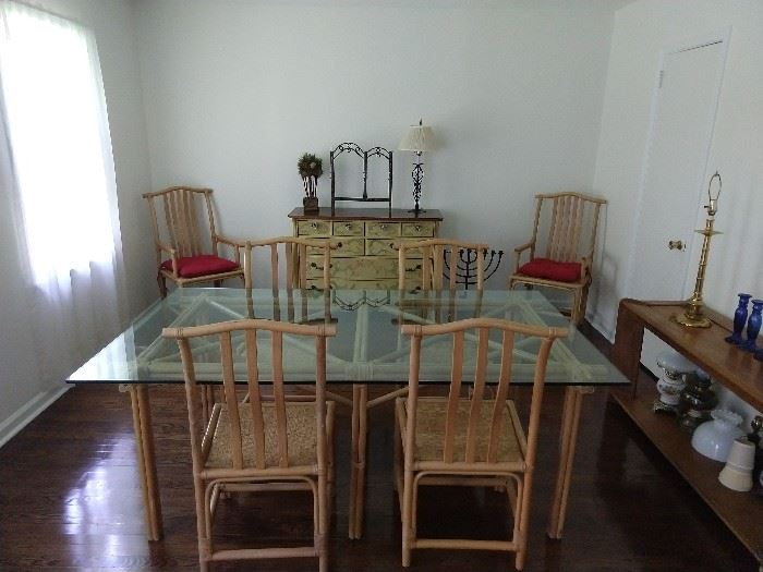 Glass topped rattan table, with six chairs - 2 arm, 4 side.