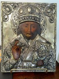 Antique Russian icon on stand.