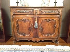 Antique French walnut hand carved server, with two drawers and double doors.