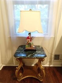 Better view of the Italin Florentine side table, with green marble top. The Asian lamp is one of a pair.                     She's coyly strumming her guitar, singing the song of her people, in hopes of wooing a huzzbun!